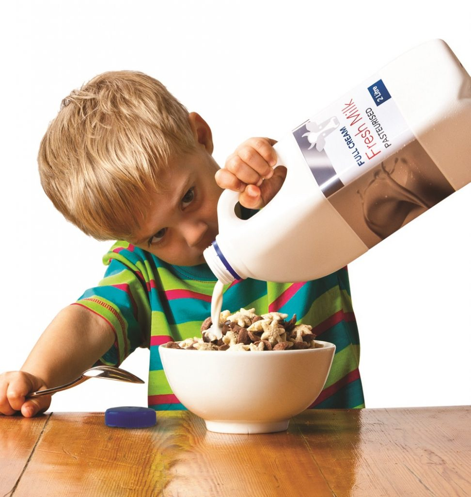 Boy pouring milk