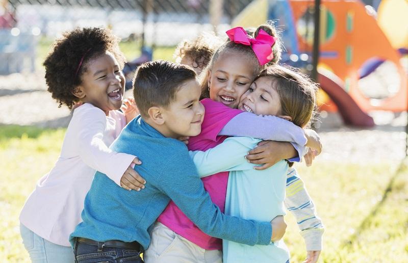 Tetraxim children hugging